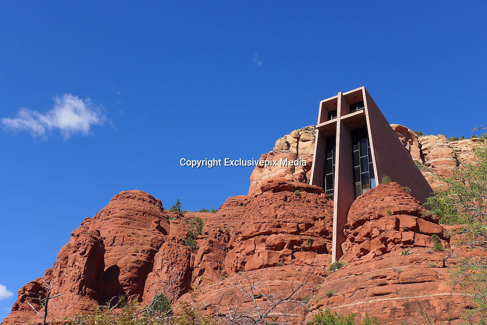 The Chapel built in the Arizona desert<br /> <br /> Jutting out of the red sandstone walls in the Arizona desert, the Chapel of the Holy Cross near the town of Sedona, is a marvel of modern architecture. The Roman Catholic chapel was designed by a student of Frank Lloyd Wright, sculptor Marguerite Brunswig Staude, who drew inspiration for its design from the newly constructed Empire State Building in New York. The chapel is directly over a butte, nearly 200 feet above the valley. The interior is very simple, with nothing more than a few pews and an alter. No traditional services are held within the chapel, as it is meant to be a place of reflection and meditation.<br /> The chapel is located on the lands of Coconino National Forest, and required a special-use permit to have it built. It was completed in 1956. The chapel belongs to the Parish of Saint John Vianney and the Roman Catholic Diocese of Pheonix.<br /> &copy;Exclusivepix Media