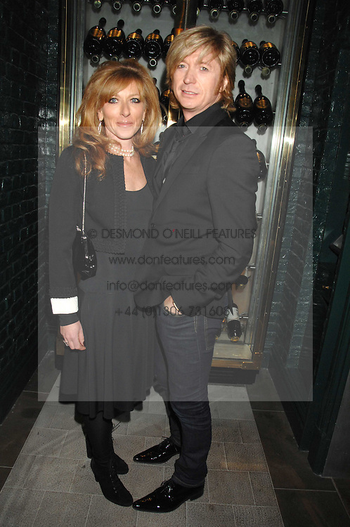 KELLY HOPPEN and NICKY CLARKE at a party to launch the Dom Perignon OEotheque 1995 held at The Landau, Portland Place, London W1 on 26th February 2008.<br /><br />NON EXCLUSIVE - WORLD RIGHTS