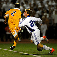 9 NOV. 2010 -- ST. LOUIS -- Christian Brothers College High School soccer player Corey Nolte (2, left) collides with St. Louis University High School's Ryan Merrifield (21) in front of the goal defended by CBC to halt a potential scoring effort by Merrifield during the second half of the MSHSAA Class 3 Sectional game at SLUH Tuesday, Nov. 9, 2010. The Jr. Bills won, 2-1, on a pair of first half goals by Merrifield. SLUH will take on Jackson High School Saturday, Nov. 13 at Jackson. Image © copyright 2010 Sid Hastings.