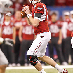 January 4, 2011; New Orleans, LA, USA; Arkansas Razorbacks quarterback Ryan Mallett (15) looks to pass against the Ohio State Buckeyes during the first quarter of the 2011 Sugar Bowl at the Louisiana Superdome.  Mandatory Credit: Derick E. Hingle