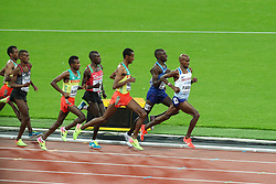 London, August 12 2017 . Mo Farah, Great Britain, leads the Paul Kipkemoi Chelimo, USA, and Yomif Kejelcha, Ethiopia, on day nine of the IAAF London 2017 world Championships at the London Stadium. © Paul Davey.