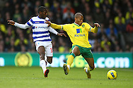 Picture by Paul Chesterton/Focus Images Ltd.  07904 640267.26/11/11.Simeon Jackson of Norwich and Shaun Wright-Phillips of QPR in action during the Barclays Premier League match at Carrow Road Stadium, Norwich.