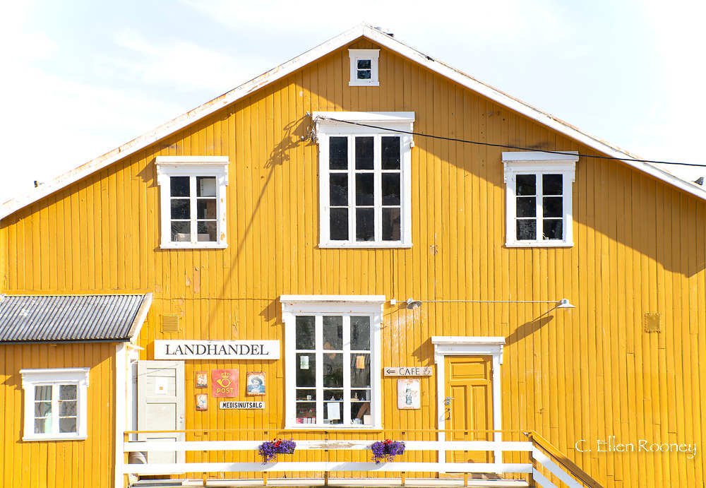 A bright yellow timber building in the fishing village of Nusfjord, Flakstadoya, Norway, Scandanavia, Europe