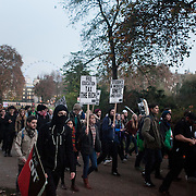A small group of students head off through Horse Guard parade and St James' Park towards Buckingham Palace. Thousands of students turned out to a march against fees and cuts in the education sector, calling for workers and students to unite against the Government's austerity policies.