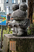 Frog statue on Nawate Dori shopping street, Matsumoto, Nagano Prefecture, Japan. Matsumoto has an annual two-day Frog Festival.