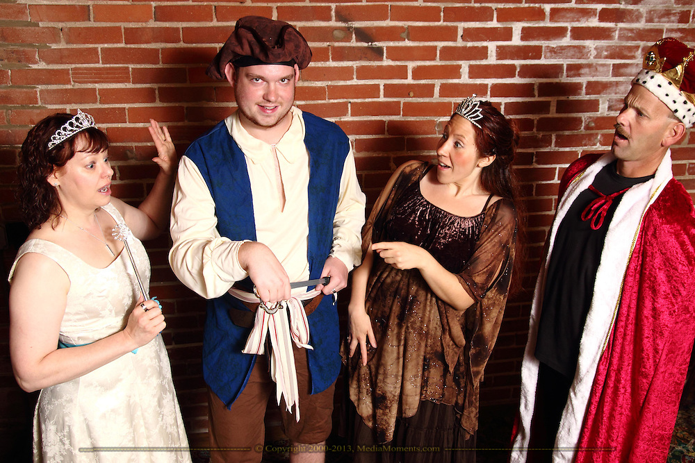 """Tamra Francis as Ashley Pelt, Joshua Lisec as Hacon Grizzlebeard, Jenne Rebbin Shaw as Kisa (the cat) and Tim Stubaker as Indigo Muttonchops during Mayhem & Mystery's rehearsal of """"Fairy Tale Facade"""" at the Spaghetti Warehouse in downtown Dayton, Sunday, September 6, 2014."""