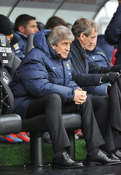 Manchester City Manager, Manuel Pellegrini - Photo mandatory by-line: Alex James/JMP - Tel: Mobile: 07966 386802 01/01/2014 - SPORT - FOOTBALL - Liberty Stadium - Swansea - Swansea City v Manchester City - Barclays Premier League
