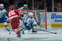 REGINA, SK - MAY 19: Josh Anderson #3 tries to block a shot on Stuart Skinner #74 of Swift Current Broncos by Olivier Galipeau #26 of Acadie-Bathurst Titan at the Brandt Centre on May 19, 2018 in Regina, Canada. (Photo by Marissa Baecker/CHL Images)