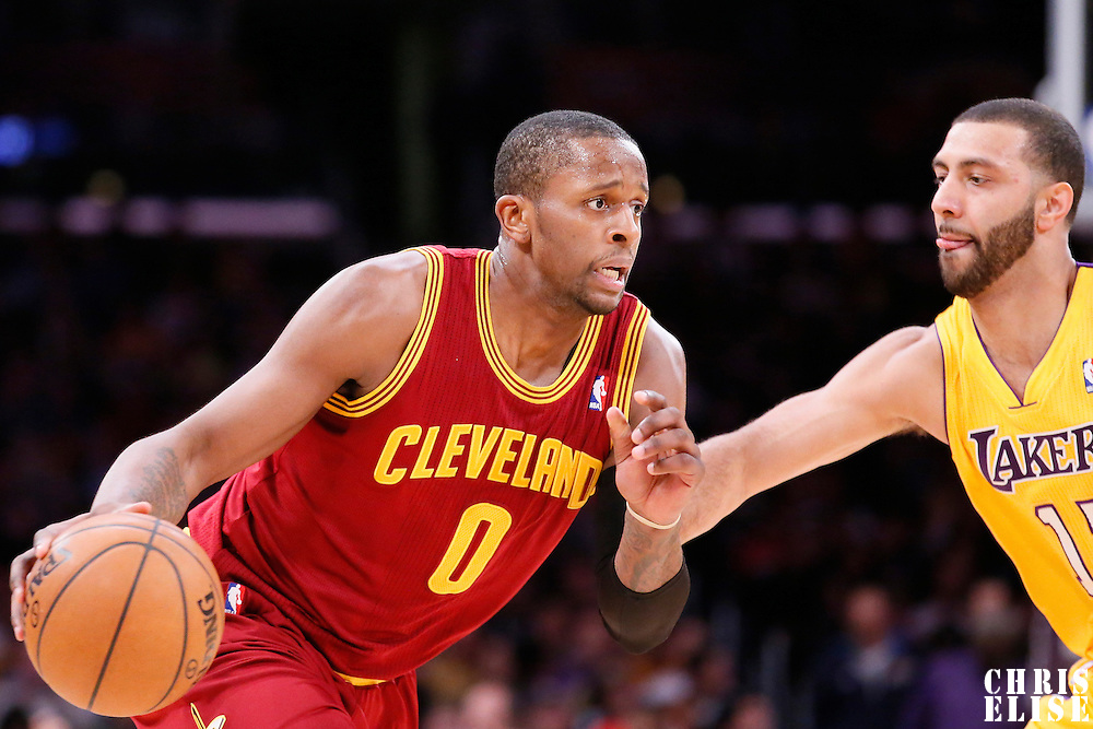 14 January 2014: Cleveland Cavaliers shooting guard C.J. Miles (0) drives past Los Angeles Lakers point guard Kendall Marshall (12) during the Cleveland Cavaliers 120-118 victory over the Los Angeles Lakers at the Staples Center, Los Angeles, California, USA.