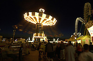 Tourists ride on a rotating swing set on the Boardwalk, Wednesday, August 7, 2002, in Wildwood, New Jersey. (Photo by William Thomas Cain/photodx.com)