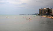 Beachgoers swim in Lake Michigan Sunday afternoon in Chicago.