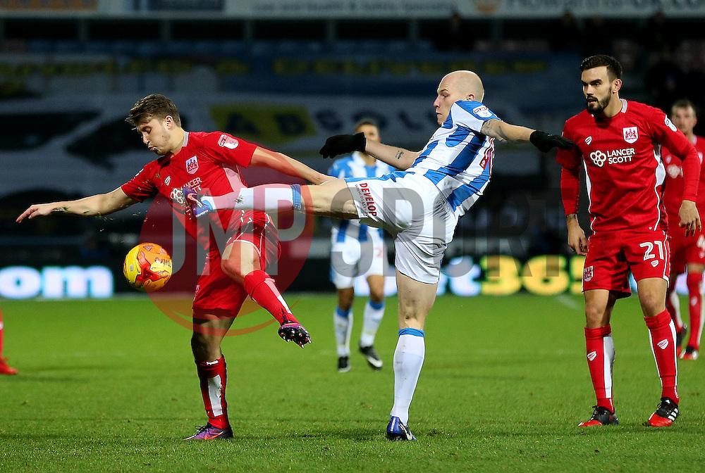 Aaron Mooy of Huddersfield Town challenges Luke Freeman of Bristol City - Mandatory by-line: Matt McNulty/JMP - 10/12/2016 - FOOTBALL - The John Smith's Stadium - Huddersfield, England - Huddersfield Town v Bristol City - Sky Bet Championship