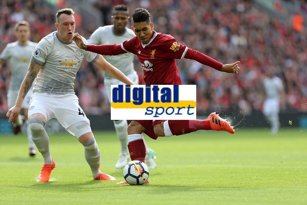 Football - 2017 / 2018 Premier League - Liverpool vs. Manchester United<br /> <br /> Roberto Firmino of Liverpool and Phil Jones of Manchester United at Anfield.<br /> <br /> COLORSPORT