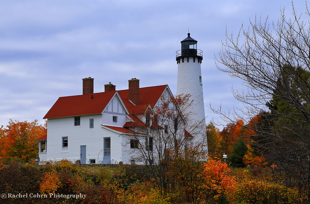 &quot;Fall Upon Iroquois&quot;<br /> <br /> Beautiful autumn colors surround the lovely Point Iroquois Light Station on Lake Superior!!<br /> <br /> Lighthouses of the Great Lakes by Rachel Cohen