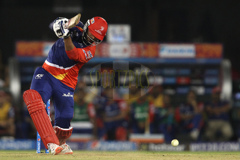 Saurabh Tiwary of the Delhi Daredevils straight drives a delivery in the last over to the boundary during match 45 of the Pepsi IPL 2015 (Indian Premier League) between The Delhi Daredevils and the Sunrisers Hyderabad held at the Shaheed Veer Narayan Singh International Cricket Stadium in Raipur, India on the 9th May 2015.<br /> <br /> Photo by:  Shaun Roy / SPORTZPICS / IPL