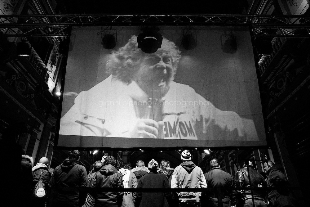 """Naples, Italy - 22 January 2013:  Comic Beppe Grillo, leader of the 5 Stars Movement in Naples, Italy, on January 22nd 2013.NAPLES, ITALY - 22 JANUARY 2013: Beppe Grillo, a comedian and leader of the 5 Stars Movement (M5S, Movimento 5 Stelle) rallies in Naples on January 22, 2013. Grillo, whom presents itself as a """"non-politician"""", and the 5 Stars Movement as """"not a party"""", has been running a mostly internet-based political campaign through the party's blog and the local groups that have emerged from it. The movement has a strong anti-politics agenda: """"All political parties are crooked and they all need to go"""", Grillo says.<br /> <br /> <br /> A general election to determine the 630 members of the Chamber of Deputies and the 315 elective members of the Senate, the two houses of the Italian parliament, will take place on 24–25 February 2013. The main candidates running for Prime Minister are Pierluigi Bersani (leader of the centre-left coalition """"Italy. Common Good""""), former PM Mario Monti (leader of the centrist coalition """"With Monti for Italy"""") and former PM Silvio Berlusconi (leader of the centre-right coalition).<br /> <br /> ###<br /> <br /> NAPOLI, ITALIA - 22 GENNAIO 2013: Beppe Grillo, comico e leader del Movimento 5 Stelle (M5S), fa un comizio a Napoli il 22 gennaio 2013. Grillo, il quale si presenta come un """"non-politica"""", e il Movimento 5 Stelle come un """"non-partito"""", svolge la maggior parte della propria campagna elettorale su internet, tramite il suo blog e i meetup locali. Il movimento ha un'agenda dalle connotazioni antipolitiche: """"I partiti sono finiti e i politici se ne devono andare"""", sostiene Grillo.<br /> <br /> Le elezioni politiche italiane del 2013 per il rinnovo dei due rami del Parlamento italiano – la Camera dei deputati e il Senato della Repubblica – si terranno domenica 24 e lunedì 25 febbraio 2013 a seguito dello scioglimento anticipato delle Camere avvenuto il 22 dicembre 2012, quattro mesi prima della conclusione naturale della XVI Legi"""