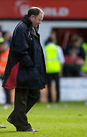 Photo: Daniel Hambury.<br />Brentford v Bristol City. Coca Cola League 1. 07/10/2006.<br />Bristol City's manager Gary Johnson looks down after his team drop two points.