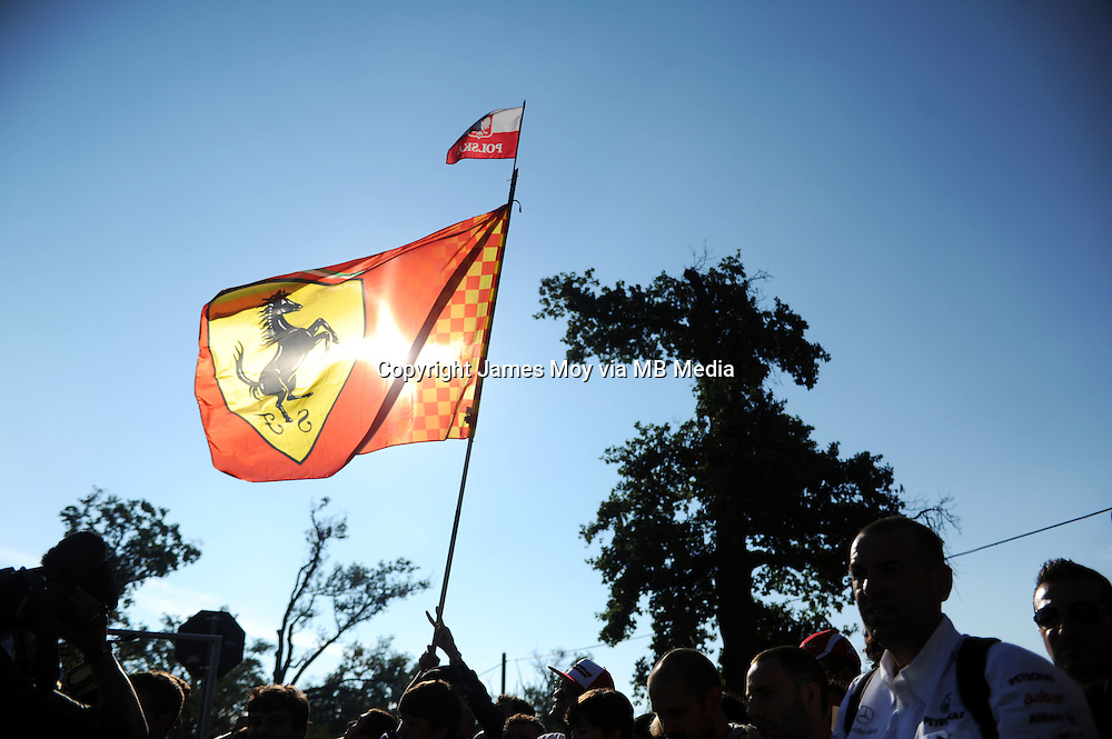 Fans and Ferrari flag.<br /> Italian Grand Prix, Saturday 6th September 2014. Monza Italy.