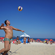 Locals play beach volleyball on Ipanema beach, Rio de Janeiro,  Brazil. 31st July 2010. Photo Tim Clayton..
