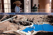 Visitors are attending the museum inside Hoover Dam, also known as Boulder Dam, standing in the Black Canyon of the Colorado River, forming Lake Mead, on the border between Nevada and Arizona, USA. Constructed between 1931 and 1936 by President Franklin D. Roosevelt, its construction was the result of a massive effort involving thousands of workers. Lake Mead is 180 km long, and when filled to capacity can reach 28 million acre-feet of water. However, the lake has not reached this capacity in more than a decade, due to increasing droughts.
