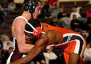 St. Charles West HIgh School wrestler Austin Rugraff (left) battles RItenour  High School's Lamar Welch in the finals of the 160-pound weight class at the St. Charles West wrestling tournament at St. Charles West High School in St. Charles Saturday, Jan. 14, 2011.  Photo © copyright 2012 Sid Hastings.