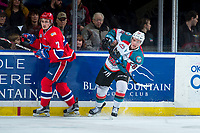 KELOWNA, CANADA - MARCH 3: Liam Kindree #26 of the Kelowna Rockets passes the puck away from Nolan Reid #7 of the Spokane Chiefs  on March 3, 2018 at Prospera Place in Kelowna, British Columbia, Canada.  (Photo by Marissa Baecker/Shoot the Breeze)  *** Local Caption ***