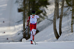 NITTA Yoshihiro competing in the Nordic Skiing XC Long Distance at the 2014 Sochi Winter Paralympic Games, Russia
