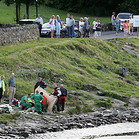 Drowning at Pitlochry Dam...12.07.05<br /> Paramedics work on a man who drowned in the River Tummel before being winched aboard the RAF Search & Rescue Sea King helicopter from RAF Lossiemouth.<br /> see story by Gordon Currie  07710 462605<br /> Picture by Graeme Hart.<br /> Copyright Perthshire Picture Agency<br /> Tel: 01738 623350  Mobile: 07990 594431