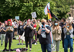 """© Licensed to London News Pictures; 18/07/2020; Bristol, UK. A Trans Rights protest rally takes place on College Green. Speakers include Shon Faye - writer, presenter, editor, artist, comedian and activist<br /> - Travis Alabanza - artist, performer, writer and theatre maker. The protest is one of many taking place across the UK today and is in protest against reported plans by the UK Government to drop reforms to the Gender Recognition Act and to introduce a law that will restrict the rights of trans women to use women's facilities, such as public toilets, changing rooms and refuges. Proposals to reform the Gender Recognition Act (GRA) would allow people to change their legal gender by """"self-identifying"""" as male or female and would let transgender people change their birth certificate without a medical diagnosis. But the Government looks set to drop these, despite 70 per cent of responses to a recent consultation of the GRA being in favour of self-identification.<br /> Campaigner say the UK Government intends to scrap the GRA reform and roll back the hard-won rights of trans and non-binary people. The Government is also allegedly planning to introduce a law that will restrict the rights of trans women to use women's facilities, such as public toilets, changing rooms and refuges. The event is calling for trans people to be able live their lives without being subjected to discrimination and abuse. Photo credit: Simon Chapman/LNP."""