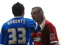 Photo: Ashley Pickering.<br />Ipswich Town v Southend United. Coca Cola Championship. 10/03/2007.<br />Southend goal scorer Peter Clarke (R) has a word with Gary Roberts of Ipswich