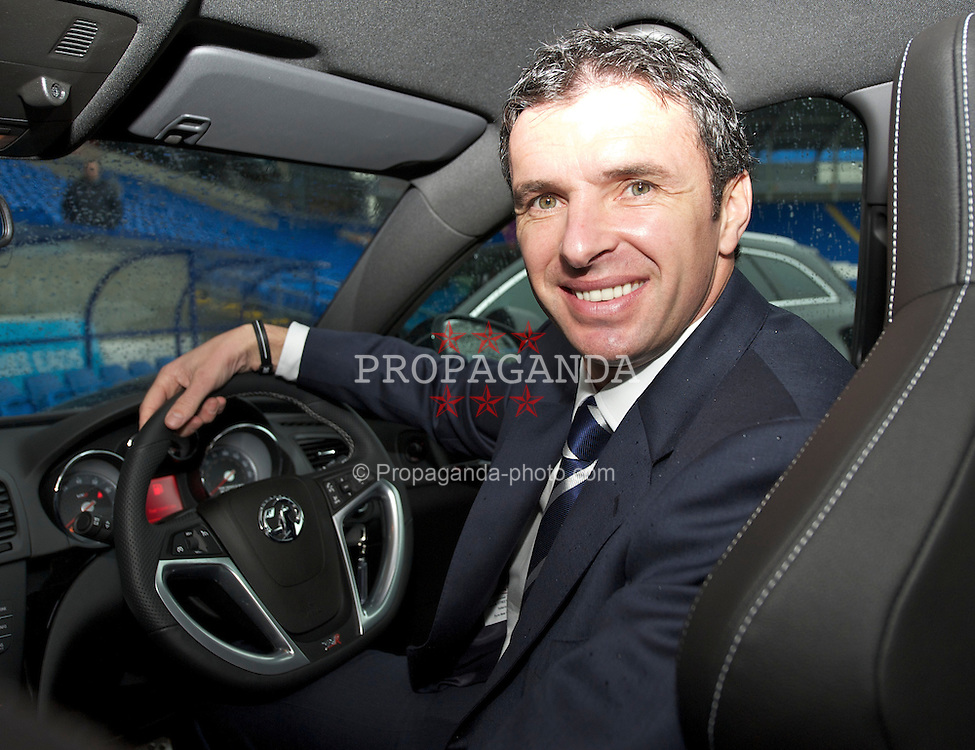 CARDIFF, WALES - Wednesday, January 12, 2011: In the driving seat... new manager Gary Speed during a photo-call to announce that British car manufacturer Vauxhall is to become the official leading sponsorship partner to the Wales international football teams, at Cardiff City Stadium. (Pic by: David Rawcliffe/Propaganda).+++ THIS IMAGE IS FREE TO USE IN CONJUNCTION WITH EDITORIAL OF VAUXHALL'S SPONSORSHIP OF THE FAW. +++