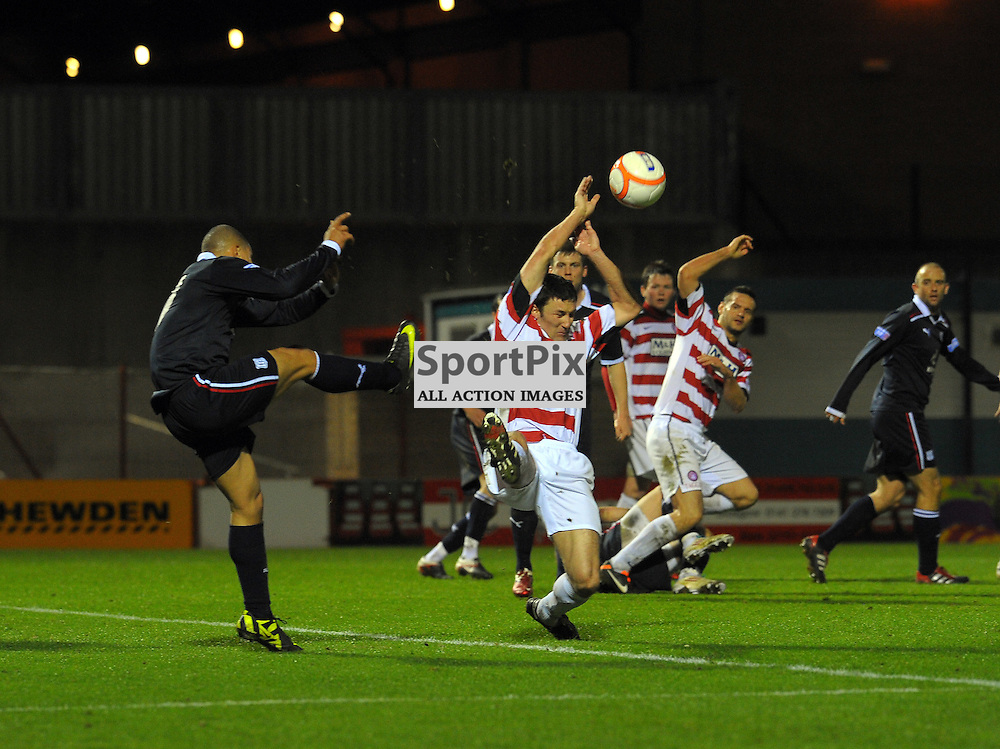 Leighton McIntosh clears the ball from Hamilton as they try to score.  Hamilton Academical vs Dundee.  Irn Bru SFL First Division match at New Douglas Park, Hamilton on 20th March 2012.