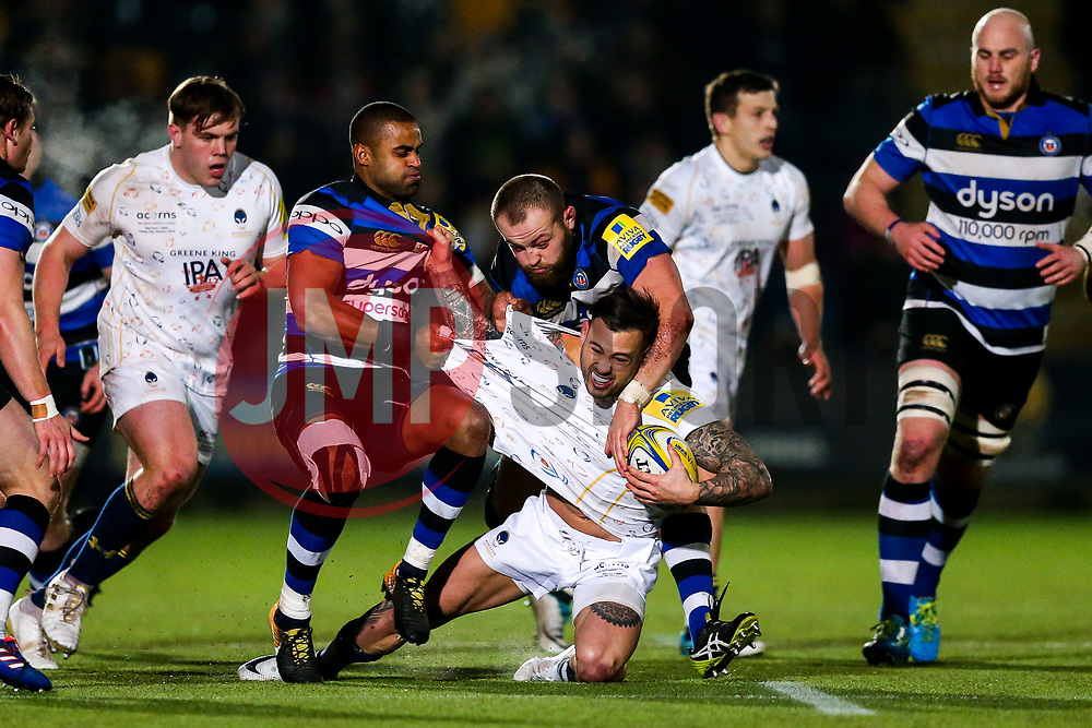 Francois Hougaard of Worcester Warriors is tackled by Tom Dunn and Aled Brew of Bath Rugby - Rogan/JMP - 05/01/2018 - RUGBY UNION - Sixways Stadium - Worcester, England - Worcester Warriors v Bath Rugby - Aviva Premiership.