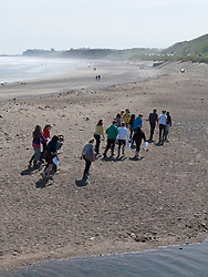 School geography lesson on the beach at Runswick Bay, Yorkshire