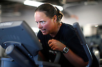 Guest Amy Davis shows her intense concentration during an interval training class at the Biggest Loser Resort in Ivins, Utah September 6, 2010.  Guests at the resort affiliated with the popular reality television show workout in an aerobics room, a gym and a swimming pool for 6 to 7 hours each day.  REUTERS/Rick Wilking (UNITED STATES)