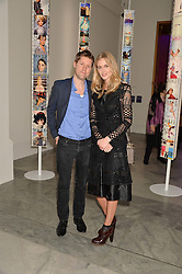 CHRISTOPHER BAILEY and DONNA AIR at the Alexandra Shulman and Leon Max hosted opening of Vogue 100: A Century of Style at The National Portrait Gallery, London on 9th February 2016.