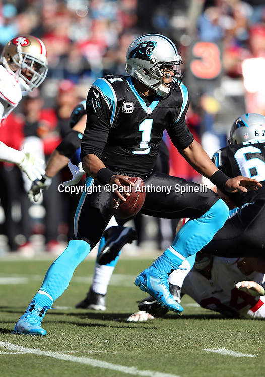 Carolina Panthers quarterback Cam Newton (1) makes a cut as he runs a keeper good for a first down on third down in the second quarter during the NFC Divisional Playoff NFL football game against the San Francisco 49ers on Sunday, Jan. 12, 2014 in Charlotte, N.C. The 49ers won the game 23-10. ©Paul Anthony Spinelli