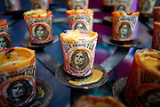 "SHOT 1/18/2007 - Religious votive candles for sale at a small store in Sayulita, Mexico. Sayulita is a small fishing village about 25 miles north of downtown Puerto Vallarta in the state of Nayarit, Mexico. Known for its rivermouth surfbreak, roving surfers ""discovered"" Sayulita in the late 60's with the construction of Mexican Highway 200. Today, Sayulita is a prosperous growing village of approximately 4,000 residents. Hailed as a popular off-the-beaten-path travel destination, Sayulita offers a variety of activities such as horseback riding, hiking, jungle canopy tours, snorkeling and fishing. Still a mecca for beginner surfers of all ages, the quaint town attracts upscale tourists with its numerous art galleries and restaurants as well. Sayulita has a curious eclectic quality, frequented by native Cora and Huichol peoples, travelling craftsmen (and women) as well as by international tourists. Sayulita is the crown jewel in the newly designated ""Riviera Nayarit"", the coastal corridor from Litibu to San Blas. It's stunning natural beauty and easy access to Puerto Vallarta have made Sayulita real estate some of the most sought after in all of Mexico..(Photo by Marc Piscotty © 2007)"