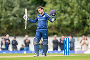 Scotland's Donald MacLeod celebrates after scoring 100 runs during the One Day International match between Scotland and Afghanistan at The Grange Cricket Club, Edinburgh, Scotland on 10 May 2019.