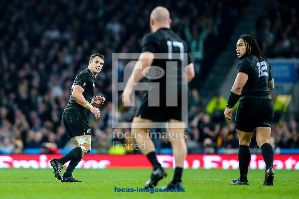 Dan Carter of New Zealand (left)  turns after scoring a drop goal during the final of the 2015 Rugby World Cup at Twickenham Stadium, Twickenham<br /> Picture by Andy Kearns/Focus Images Ltd 0781 864 4264<br /> 31/10/2015