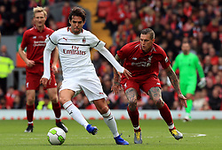 Milan's Kaka and Liverpool's Daniel Agger battle for the ball during the Legends match at Anfield Stadium, Liverpool.
