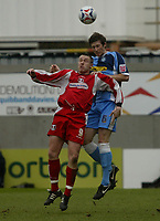 Photo: Chris Ratcliffe.<br />Leyton Orient v Wycombe Wanderers. Coca Cola League 2. 25/03/2006.<br />Gary Alexander of Leyton Orient goes up for a header with Mike Williamson of Wycombe