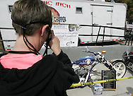 "A woman takes pictures of a $100,000 custom chopper built by Alan Bernard of Santiago Chopper in support of Mark Lunsford.  Lunsford's daughter, nine-year-old Jessica, was kidnapped and murdered by a registered sex offender.  She was reported missing exactly two years ago on Feb. 24, 2005.  Lunsford has spent the past two years raising awareness and working to pass ""Jessica's Act"" strengthening penalties against child predators.  To date, the act has passed in 26 states."