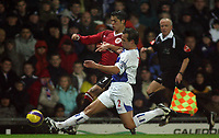 Photo: Paul Thomas.<br /> Blackburn Rovers v Manchester United. The Barclays Premiership. 11/11/2006.<br /> <br /> Blackburn's Lucas Neill (R) tackles Cristiano Ronaldo.
