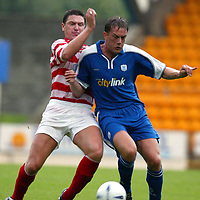 St Johnstone v Hamilton Accies 06.08.02<br />Ian Maxwell fends off Ally Graham<br /><br />Pic by Graeme Hart<br />Copyright Perthshire Picture Agency<br />Tel: 01738 623350 / 07990 594431