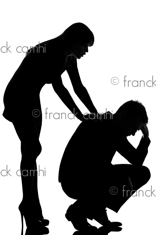 one caucasian couple man sad  and woman caring consoling in studio silhouette isolated on white background