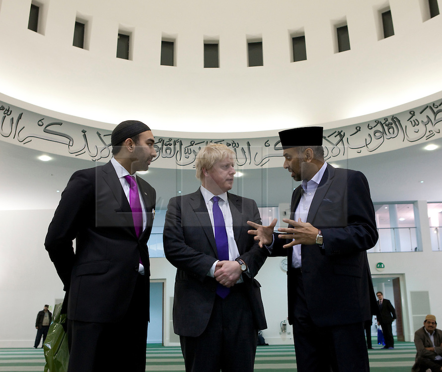 © Licensed to London News Pictures. 24/03/2012. Surrey, U.K..Boris Johnson on a tour of Europe's largerst mosque, Baitul Futuh Mosque, in Morden, Surrey, which holds 10,000 worshipers. .Parliamentarians and religious, civic, charitable and community leaders meet here this evening 24/3/2012 for a National Peace Symposium on International Peace organised by the Ahmadiyya Muslim community to hear how Muslims are countering extremism..Photo credit : Rich Bowen/LNP