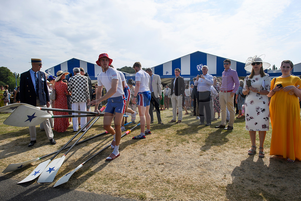 © Licensed to London News Pictures. 04/07/2018. Henley-on-Thames, UK. Family and friends watch as a team takes their oars to the water on day one of the Henley Royal Regatta, set on the River Thames by the town of Henley-on-Thames in England. Established in 1839, the five day international rowing event, raced over a course of 2,112 meters (1 mile 550 yards), is considered an important part of the English social season. Photo credit: Ben Cawthra/LNP
