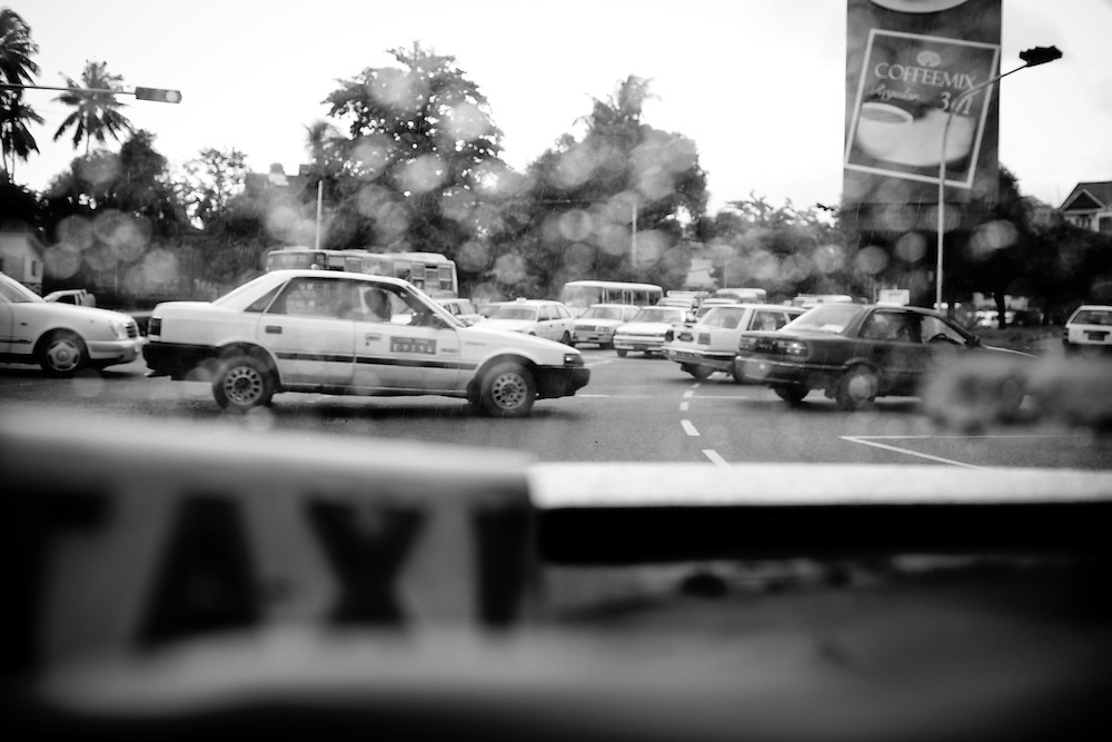 The traffic in Yangon, Myanmar, as seen through the back of an aging taxi.