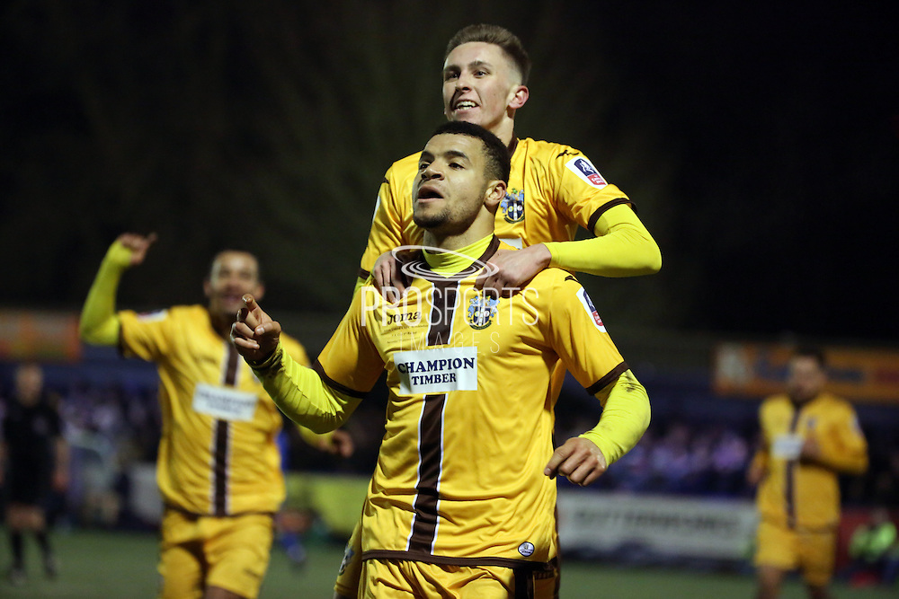 Sutton United striker Maxime Biamou (24) celebrating scoring and winning the game during the The FA Cup third round replay match between AFC Wimbledon and Sutton United at the Cherry Red Records Stadium, Kingston, England on 17 January 2017. Photo by Matthew Redman.